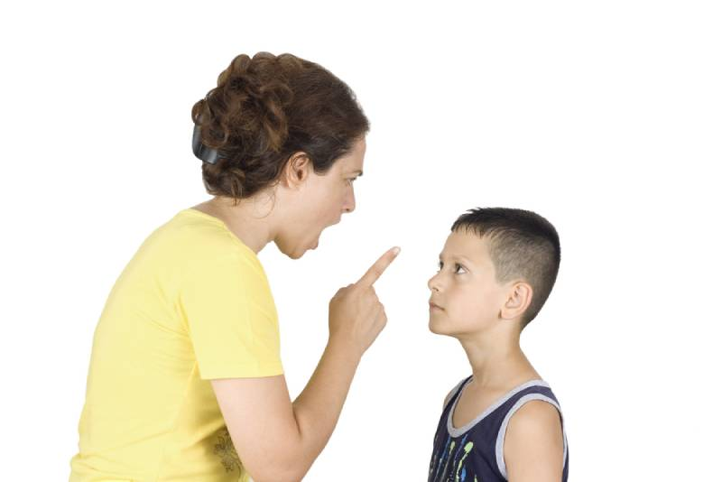 Boy confronts his mother while she yells at him on white background