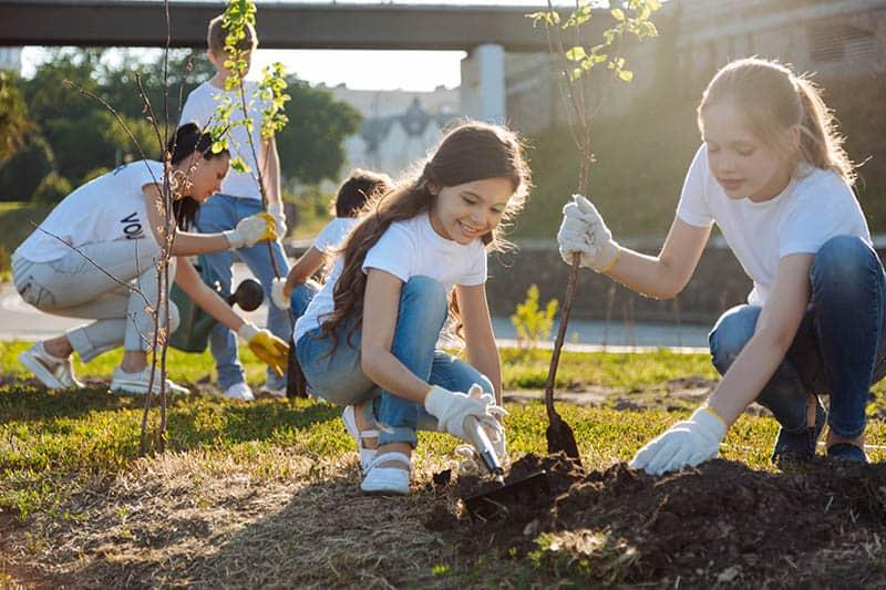 girl planting trees in volunteer action