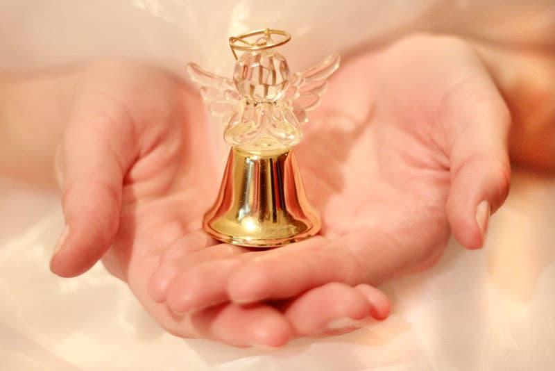 woman holding baby angel figure