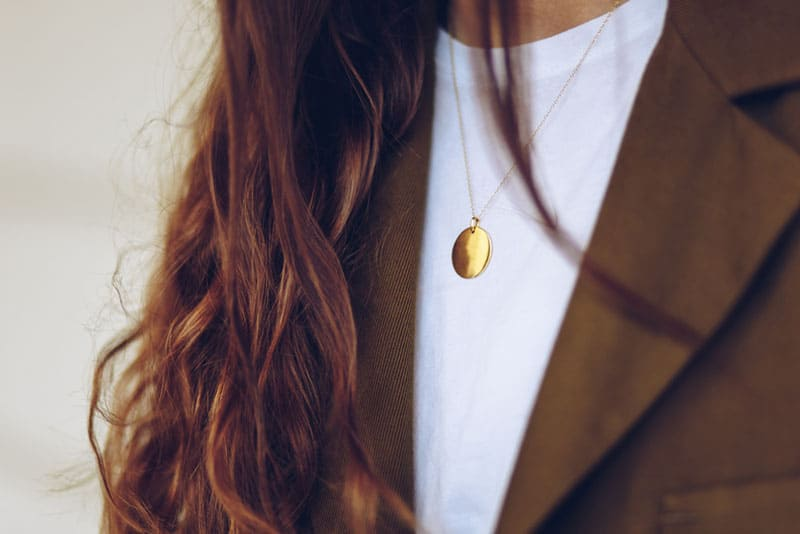woman wearing a golden necklace