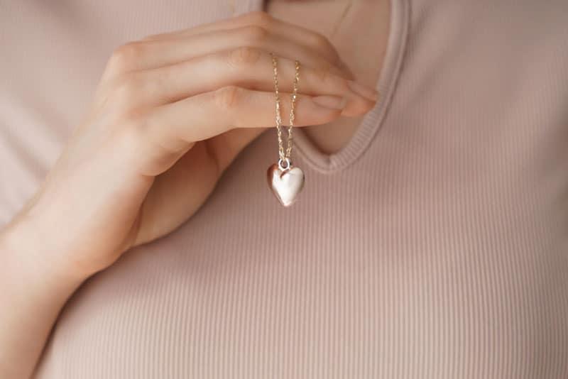 woman wearing heart-shaped necklace