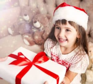 Mother gives a Christmas gift to her daughter