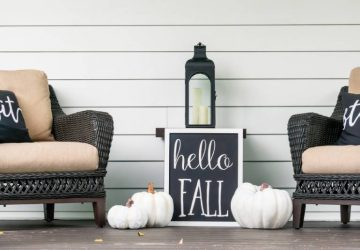 Stylish fall decorations in black and white on the front porch
