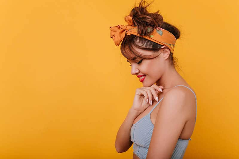 woman with hair accessories with orange background