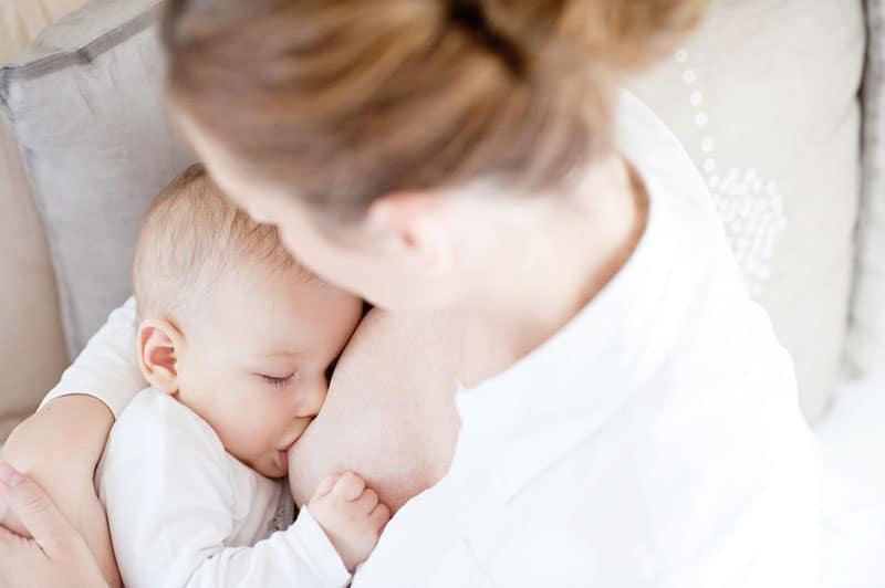 mother breastfeeding sleeping baby
