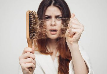 girl with a comb and problem hair on white background