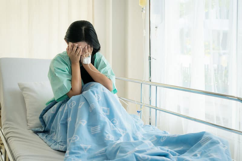 sad woman crying on the hospital bed