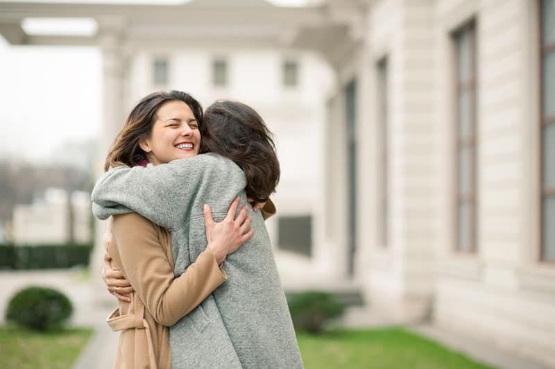 two girls hugging outdoor