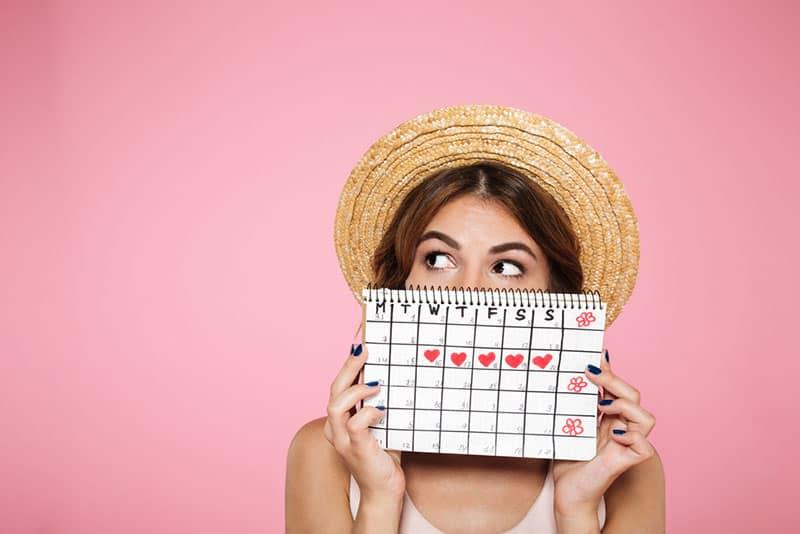 woman holding period calendar