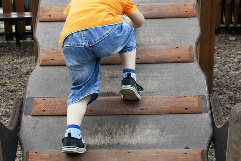 young kid toddle climbing developing gross motor skills