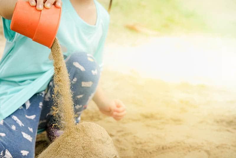 kid toddler playing in sand