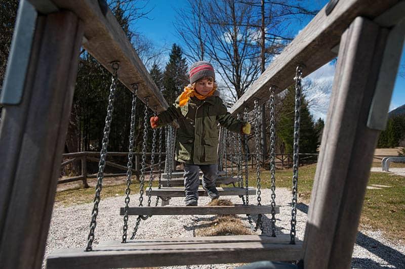 kid playing in park gross motor skills