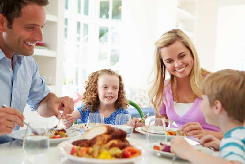 Family of 4 eating together at home