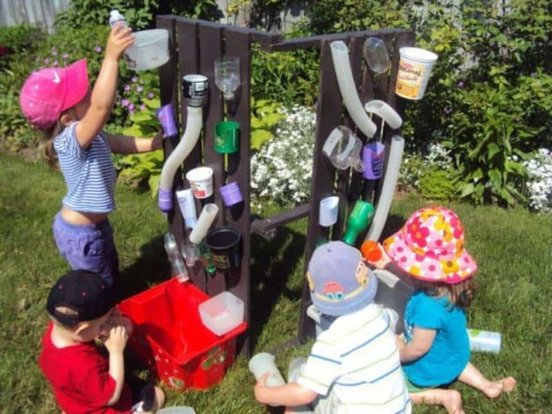 Kids playing outdoors and making water wall