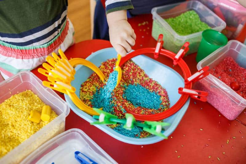 Kids playing with sensory bin at home