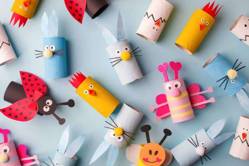 Collection of toys from toilet roll tube on blue background