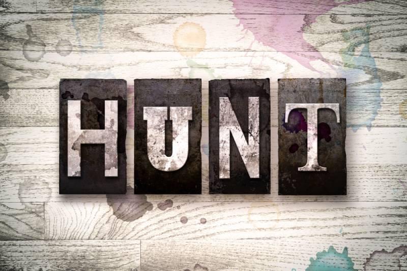 """The word """"HUNT"""" written in vintage dirty metal"""