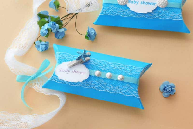 Cute blue baby shower favor on light background