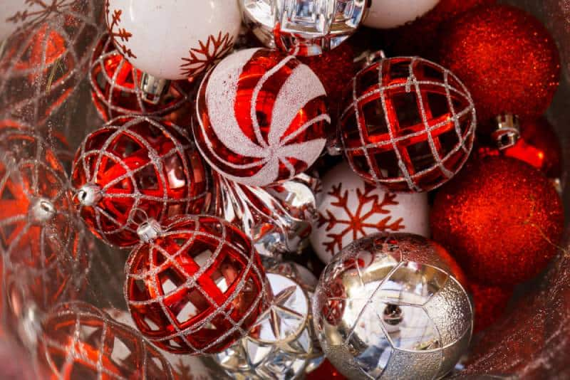 Bucket of red Christmas Ornaments