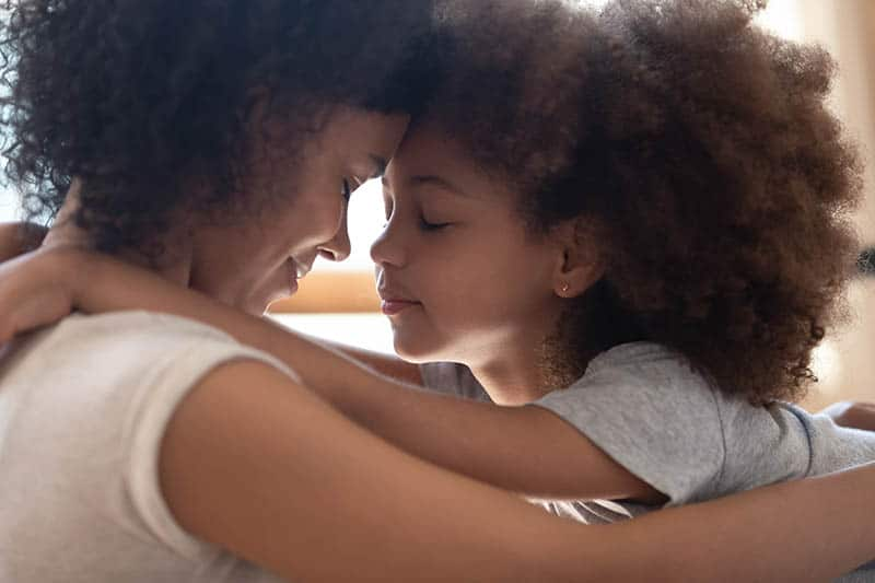 african american single mother with daughter