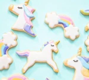 unicorn cookies on turquoise background