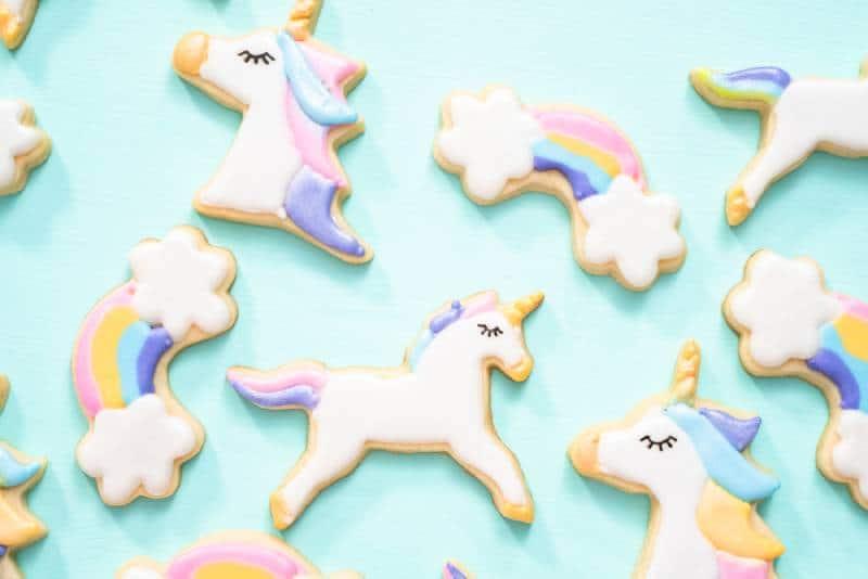 unicorn cookies on turquoise background