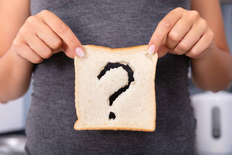 Woman Hands Holding Sliced Bread With Question Mark Sign