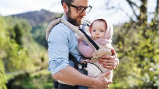father carrying baby in the carrier