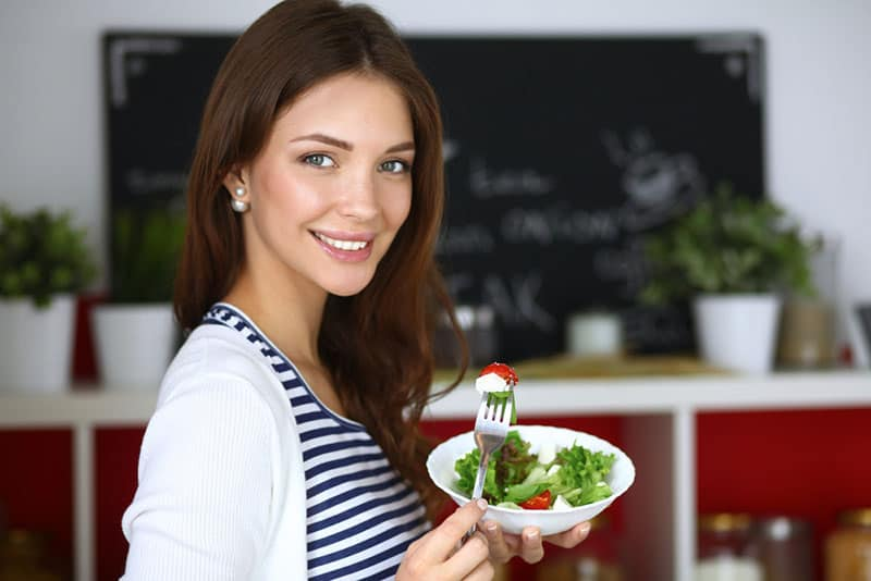 beautiful woman eating healthy meal