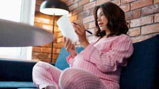 pregnant woman writing a list