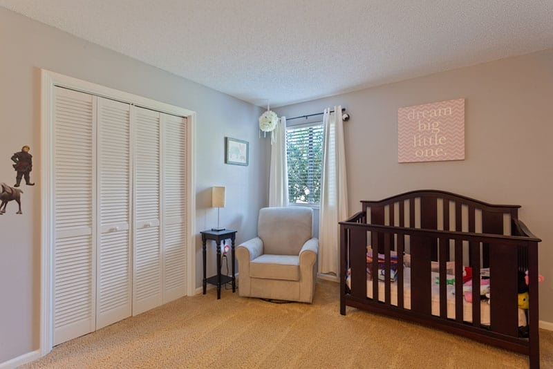 nursery glider in a baby room