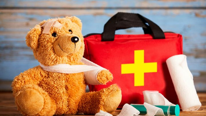 first aid kit with injured teddy bear