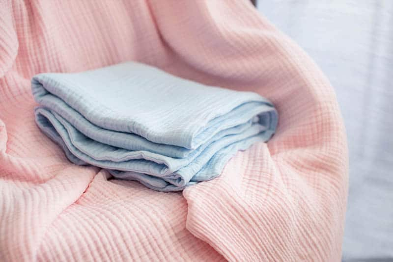 blue and pink baby blankets on the chair