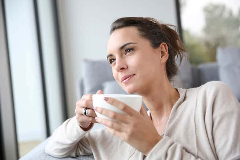calm woman enjoying the coffee