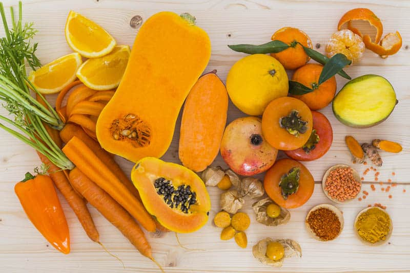 orange vegetables and fruits on the table
