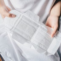 woman holding sanitary pad in hands