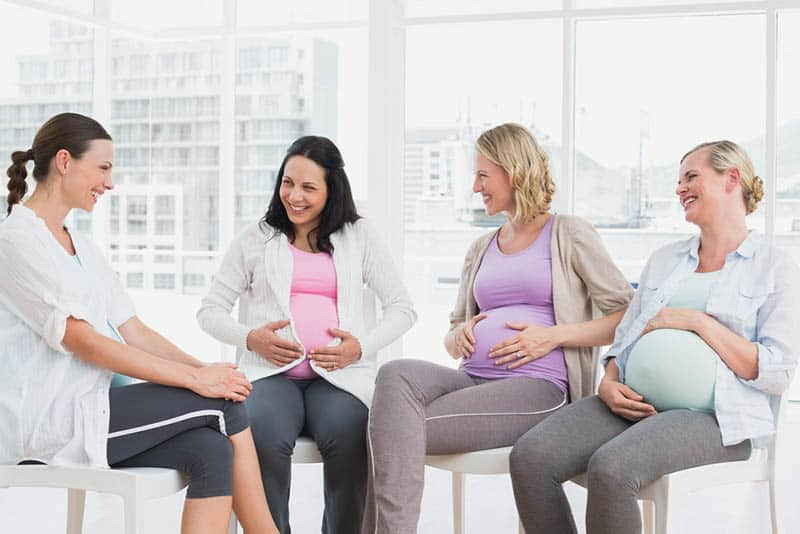 pregnant women talking together on antenatal class