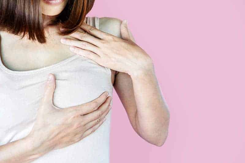 woman holding for painful breast