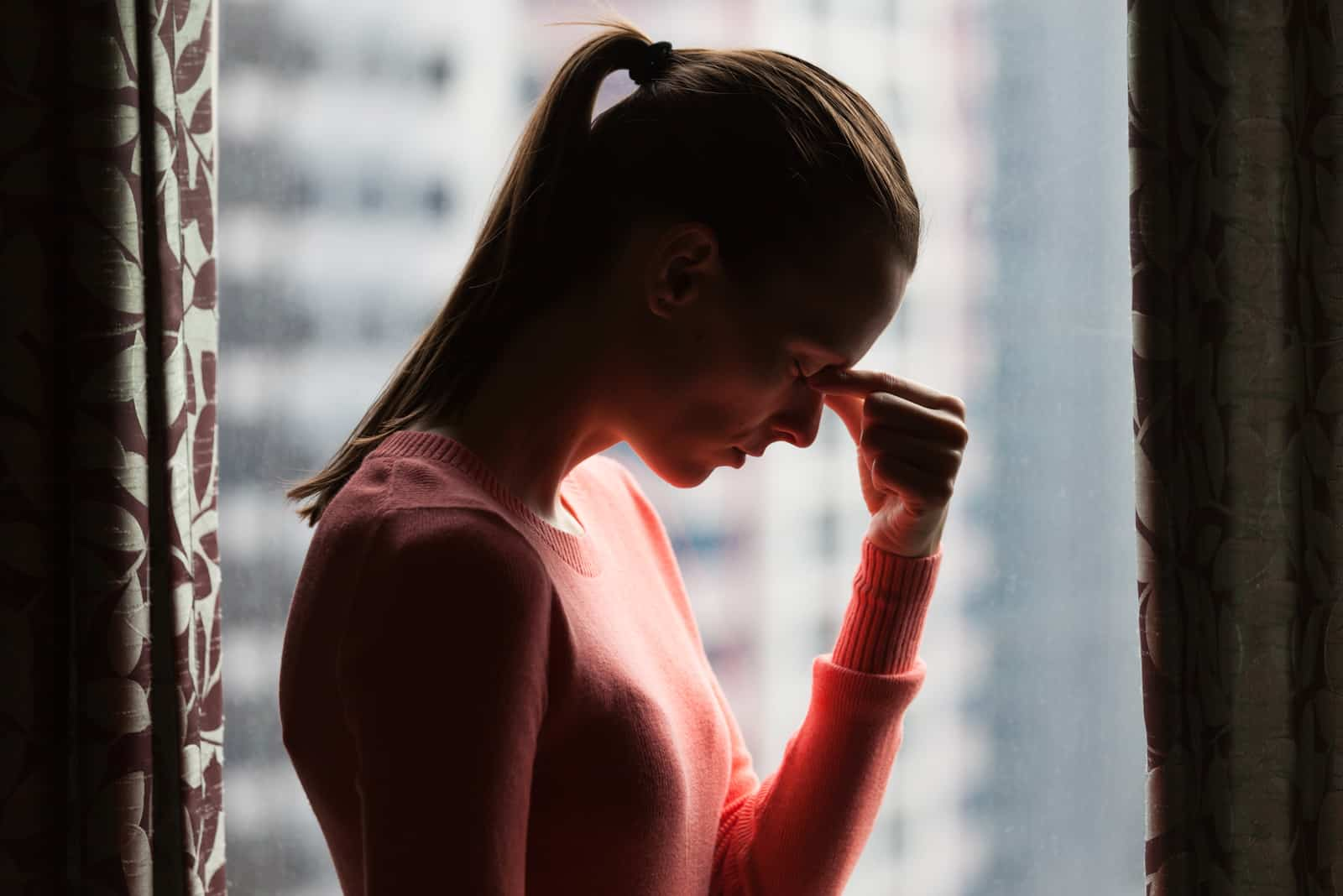 worried woman having a headache