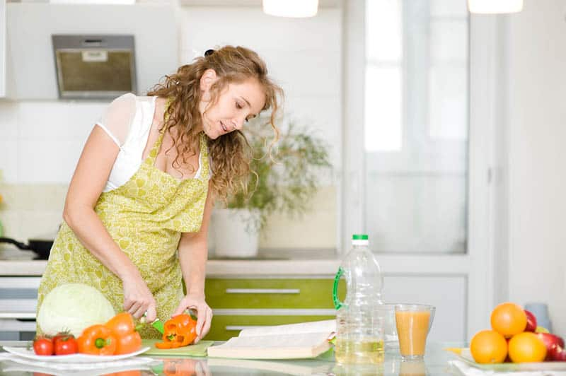 young mother preparing the meal after the recipe