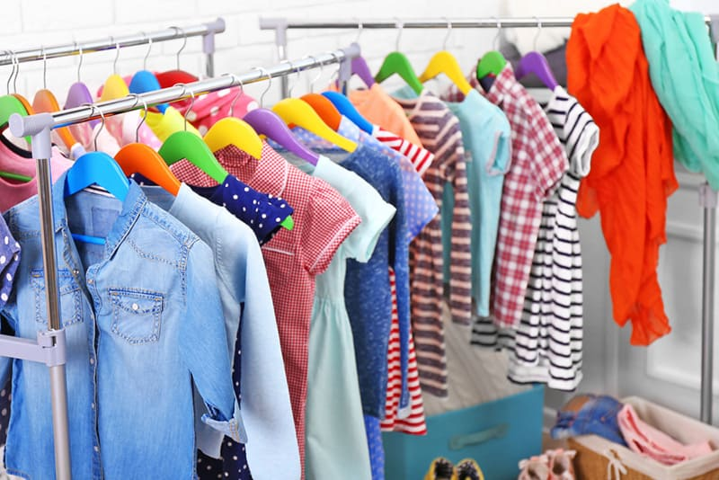 a lot of colorful clother for kids on hangers