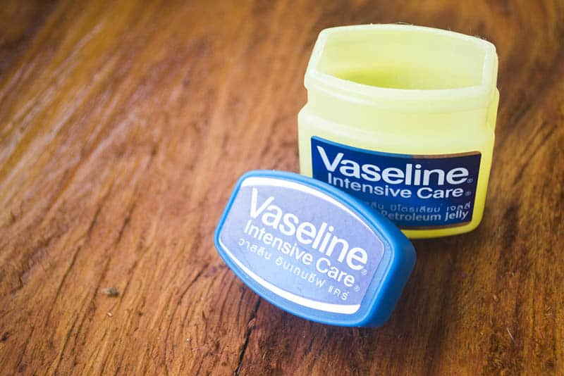 package of opened vaseline petroleum on the wooden table