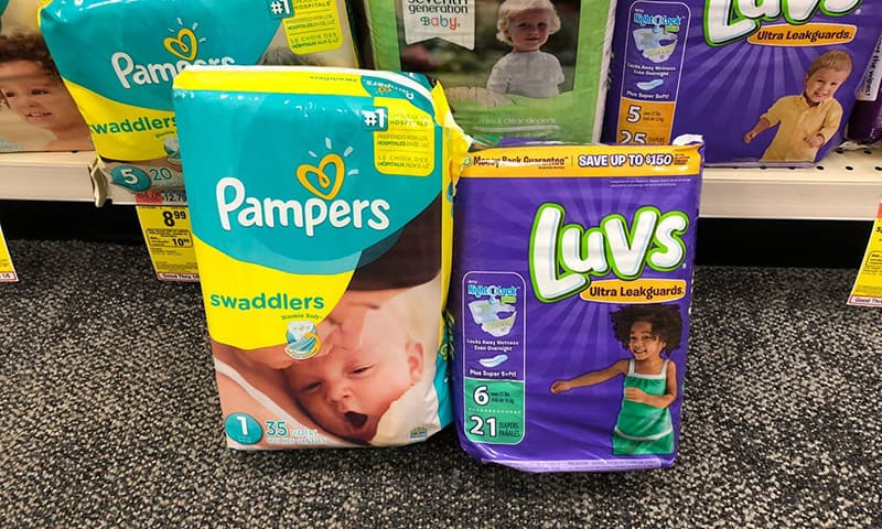 package of pampers and luvs baby diapers in store
