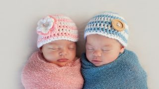 twin newborn babies sleeping