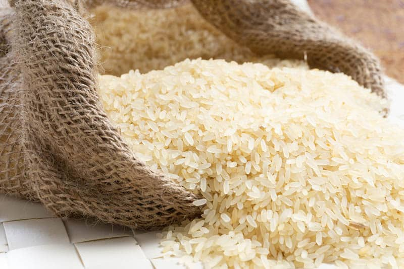 Rice in jute natural bag on the table