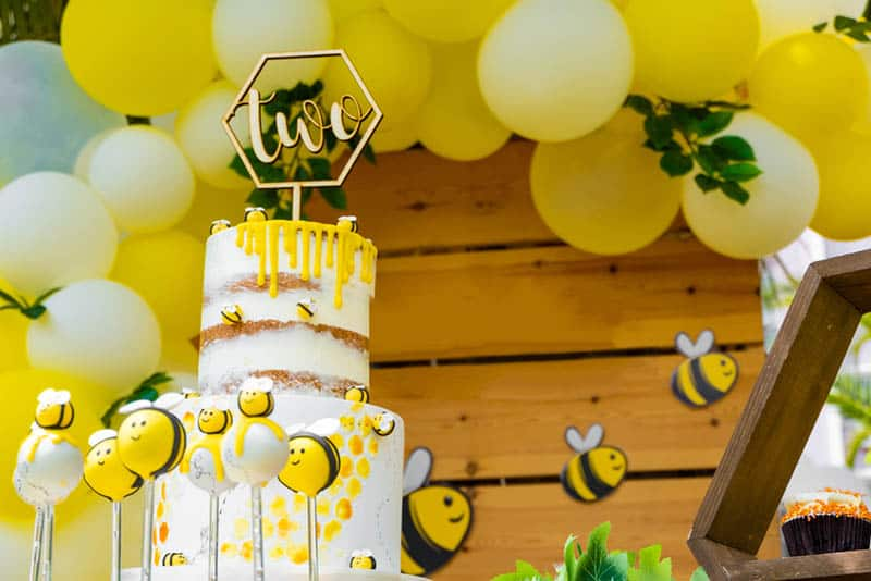 bee themed shower party for baby with big cake