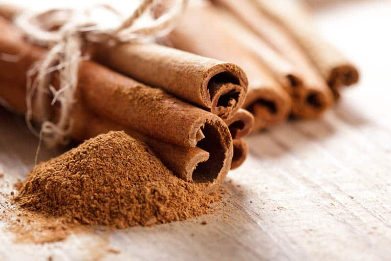 cinnamon sticks with powder on the table