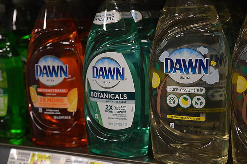 colorful bottles of Dawn liquid detergents on the shell in store