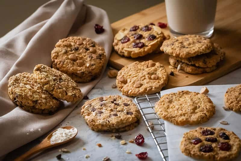 delicious lactation cookies with raisins and a glass of milk on the table