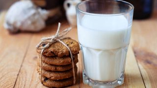 lactation cookies served with a glass of milk on the table